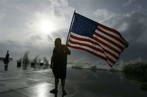 <div class='meta'><div class='origin-logo' data-origin='none'></div><span class='caption-text' data-credit='AP Photo/ Matt Slocum'>Robert Shumake walks down the seawall as waves roll in from Hurricane Ike, Friday, Sept. 12, 2008, in Galveston, Texas. (AP Photo/Matt Slocum)</span></div>