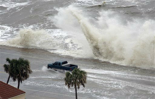 "<div class=""meta image-caption""><div class=""origin-logo origin-image none""><span>none</span></div><span class=""caption-text"">A truck drives along the seawall as waves crash over the partially flooded road as Hurricane Ike approaches Friday, Sept. 12, 2008 in Galveston, Texas. (AP Photo/David J. Phillip) (AP Photo/ David J. Phillip)</span></div>"