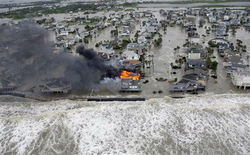"<div class=""meta image-caption""><div class=""origin-logo origin-image none""><span>none</span></div><span class=""caption-text"">Fire destroys homes along the beach on Galveston Island, Texas as Hurricane Ike approaches Friday, Sept. 12, 2008. (AP Photo/David J. Phillip) (AP Photo/ David J. Phillip)</span></div>"