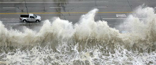 "<div class=""meta image-caption""><div class=""origin-logo origin-image none""><span>none</span></div><span class=""caption-text"">A truck drives along the seawall past crashing waves as Hurricane Ike approaches Friday, Sept. 12, 2008 in Galveston, Texas. (AP Photo/David J. Phillip) (AP Photo/ David J. Phillip)</span></div>"
