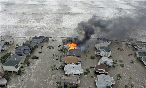 <div class='meta'><div class='origin-logo' data-origin='none'></div><span class='caption-text' data-credit='AP Photo/ David J. Phillip'>A home burns as waves from Hurricane Ike crash the shoreline Friday, Sept. 12, 2008 in Galveston, Texas. (AP Photo/David J. Phillip)</span></div>