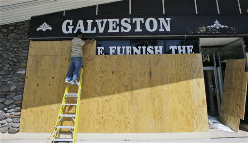 "<div class=""meta image-caption""><div class=""origin-logo origin-image none""><span>none</span></div><span class=""caption-text"">Adrian Demetreo boards the windows of Galveston Furniture Thursday, Sept. 11, 2008 in Galveston, Texas. (AP Photo/ David J. Phillip)</span></div>"