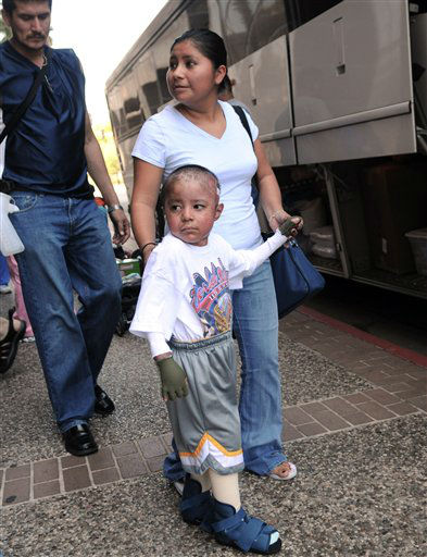 "<div class=""meta image-caption""><div class=""origin-logo origin-image none""><span>none</span></div><span class=""caption-text"">Patients from the Shriner Hospital of Galveston are evacuated in advance of Hurricane Ike Thursday, Sept. 11, 2008 in Galveston, Texas. (AP Photo/ Kim Christensen)</span></div>"