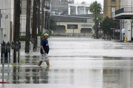 "<div class=""meta image-caption""><div class=""origin-logo origin-image none""><span>none</span></div><span class=""caption-text"">Rudy Betancourt walks through a flooded street after boarding up his business in downtown Galveston, Texas, as Hurricane Ike approaches, Friday, Sept. 12, 2008. (AP Photo/ Matt Slocum)</span></div>"