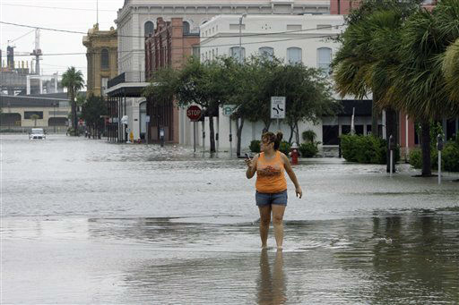 "<div class=""meta image-caption""><div class=""origin-logo origin-image none""><span>none</span></div><span class=""caption-text"">Estella Morales walks through a flooded street after checking on a friend's business in downtown Galveston, Texas, as Hurricane Ike approaches, Friday, Sept. 12, 2008. (AP Photo/ Matt Slocum)</span></div>"