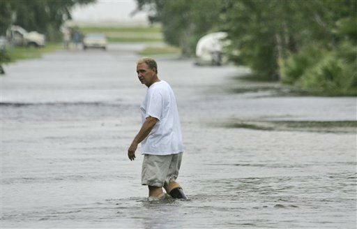 <div class='meta'><div class='origin-logo' data-origin='none'></div><span class='caption-text' data-credit='AP Photo/ LM Otero'>A man walks down a flooded street in Galveston, Texas, Friday, Sept. 12, 2008.</span></div>