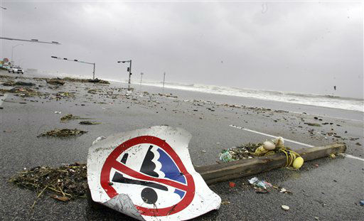 "<div class=""meta image-caption""><div class=""origin-logo origin-image none""><span>none</span></div><span class=""caption-text"">Debris brought ashore by waves created by Hurricane Ike lay on the road atop the sea wall in Galveston, Texas, Friday, Sept. 12, 2008. (AP Photo/ LM Otero)</span></div>"