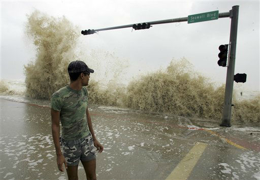 "<div class=""meta image-caption""><div class=""origin-logo origin-image none""><span>none</span></div><span class=""caption-text"">Evan Norcom looks at a wave from Hurricane Ike while standing on the sea wall in Galveston, Texas, Friday, Sept. 12, 2008. (AP Photo/ LM Otero)</span></div>"