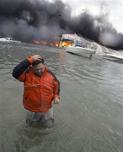"<div class=""meta image-caption""><div class=""origin-logo origin-image none""><span>none</span></div><span class=""caption-text"">With Hurricane Ike offshore, Michael Gardner walks in high water in front of a burning marina warehouse in Galveston, Texas, Friday, Sept. 12, 2008. (AP Photo/ LM Otero)</span></div>"