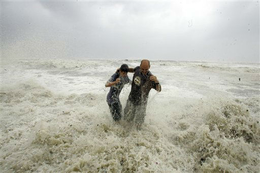 <div class='meta'><div class='origin-logo' data-origin='none'></div><span class='caption-text' data-credit='AP Photo/ LM Otero'>Steve Owen, right, and his son Austin Owen, 13, are swamped by a wave from hurricane Ike while standing on the sea wall in Galveston, Texas, Friday, Sept. 12, 2008.</span></div>