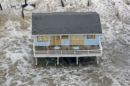 "<div class=""meta image-caption""><div class=""origin-logo origin-image none""><span>none</span></div><span class=""caption-text"">In this photo taken Sept. 12, 2008, a boarded up home sits along the beach as Hurricane Ike approaches Galveston, Texas. (AP Photo/ David J. Phillip)</span></div>"