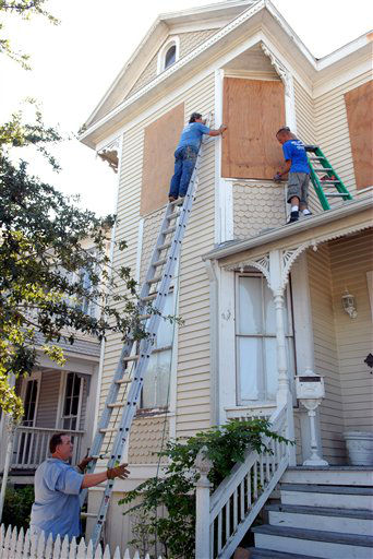 <div class='meta'><div class='origin-logo' data-origin='none'></div><span class='caption-text' data-credit='AP Photo/ Kim Christensen'>Rusty Legg, left, holds the ladder for John Moore as Chris Robertson boards up the window on Legg's 1895 home in advance Hurricane Ike Thursday, Sept. 11, 2008.</span></div>