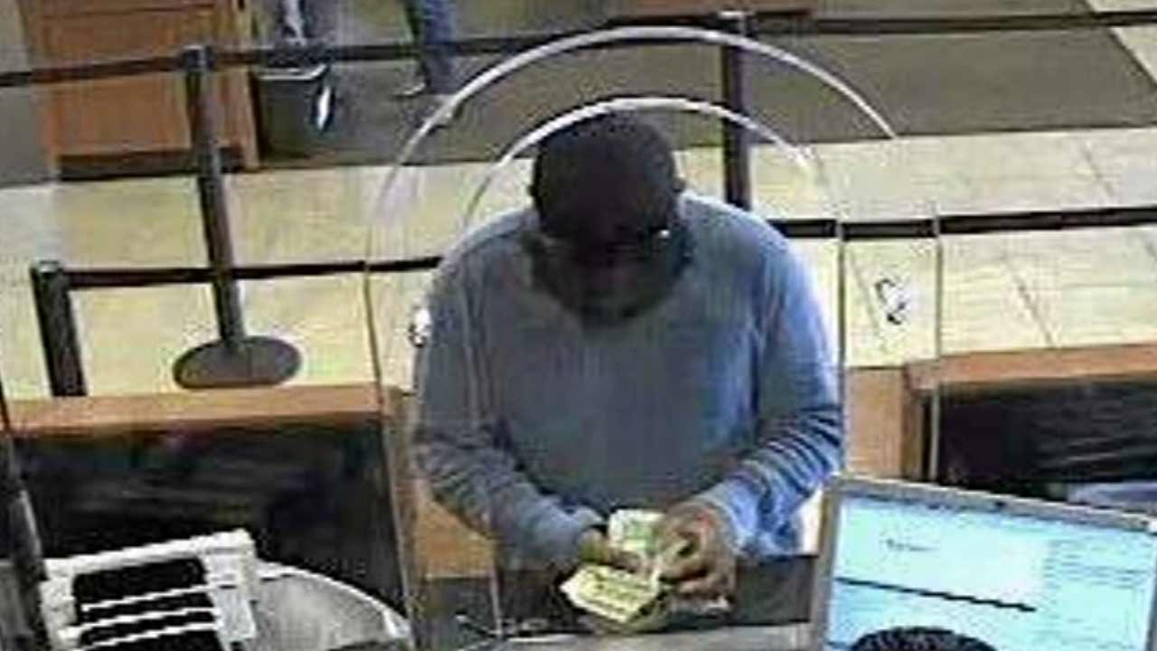 A surveillance still image shows a suspect dubbed the 'Bluto Bandit' during a bank robbery in Southern California.