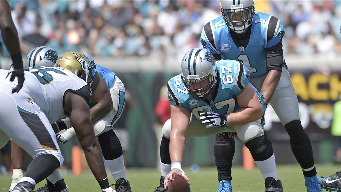 Carolina Panthers quarterback Cam Newton (1) lines up under center Ryan Kalil (67) for a play against the Jacksonville Jaguars during the first half of an NFL football game in Jacksonville, Fla., Sunday, Sept. 13, 2015.