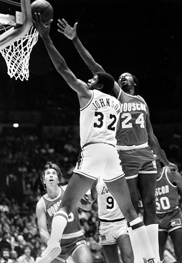 """<div class=""""meta image-caption""""><div class=""""origin-logo origin-image none""""><span>none</span></div><span class=""""caption-text"""">Earvin """"Magic"""" Johnson (32) goes up to score two of his game-high 30 points getting past Houston Rockets Moses Malone (24) (AP Photo/ MCLENDON)</span></div>"""
