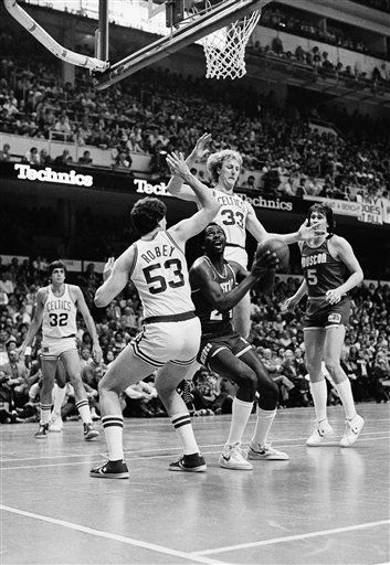 """<div class=""""meta image-caption""""><div class=""""origin-logo origin-image none""""><span>none</span></div><span class=""""caption-text"""">Moses Malone of the Houston Rockets, center, prepares to go up against Rick Robey and Larry Byrd. (AP Photo/ Anonymous)</span></div>"""