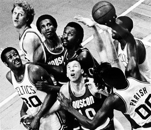 "<div class=""meta image-caption""><div class=""origin-logo origin-image none""><span>none</span></div><span class=""caption-text"">Boston Celtics Robert Parish takes a shot over Houston Rockets Mike Dunlevy (10), Moses Malone, center, and Major Jones (AP Photo/ XMB)</span></div>"