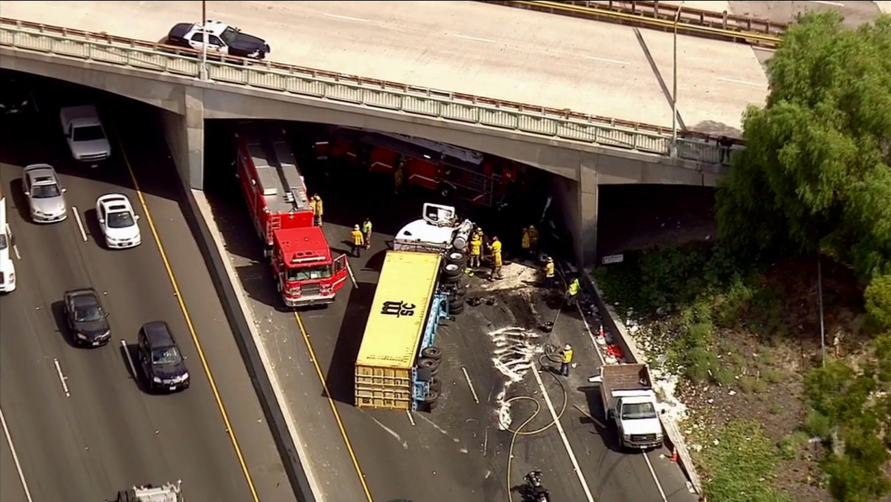 Firefighters respond to a fatal accident involving a big rig on the northbound 710 Freeway on Monday, Sept. 14, 2015.