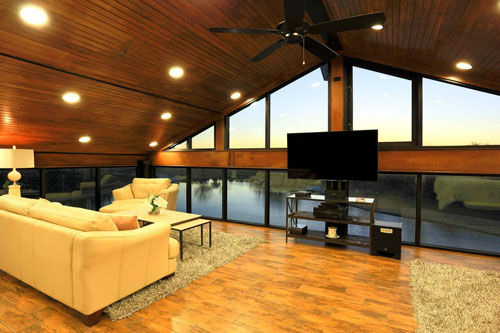 """<div class=""""meta image-caption""""><div class=""""origin-logo origin-image none""""><span>none</span></div><span class=""""caption-text"""">This one of a kind 'glass house' has 3-levels of breath-taking views. The luxury home sits on a private lake and is only accessible by boat or bridge. (Bill Krampitz/TK Images)</span></div>"""