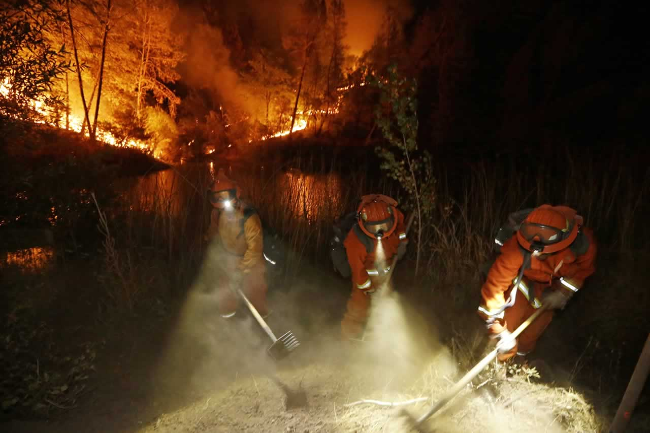"<div class=""meta image-caption""><div class=""origin-logo origin-image none""><span>none</span></div><span class=""caption-text"">Firefighters create a firebreak near a home in Middletown, Calif., on Sunday, Sept. 13, 2015. (AP Photo/Elaine Thompson)</span></div>"