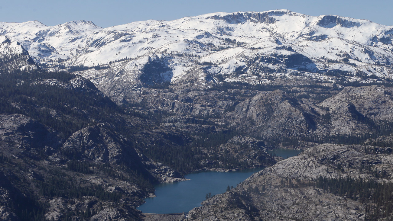 A Sierra Nevada lake surrounded by snow barren ridges, that are usually covered in snow this time of year, are seen during an aerial survey of the snowpack.