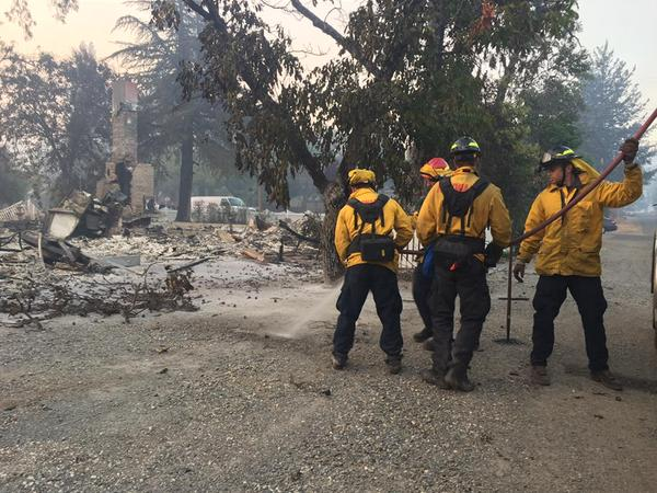 "<div class=""meta image-caption""><div class=""origin-logo origin-image none""><span>none</span></div><span class=""caption-text"">Firefighters assigned to the Valley Fire work to put out hot spots in Middletown, Calif., on Tuesday, September 15, 2015. (KGO-TV)</span></div>"