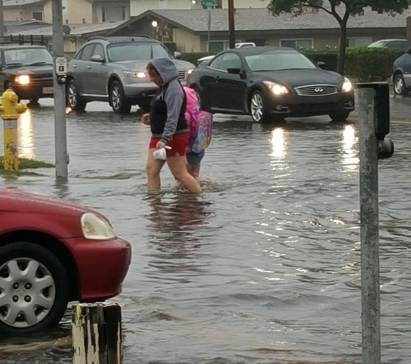 """<div class=""""meta image-caption""""><div class=""""origin-logo origin-image kabc""""><span>KABC</span></div><span class=""""caption-text"""">A mother and child walk to school through a flooded road in Corona on Tuesday, Sept. 15, 2015. (ABC7 viewer)</span></div>"""