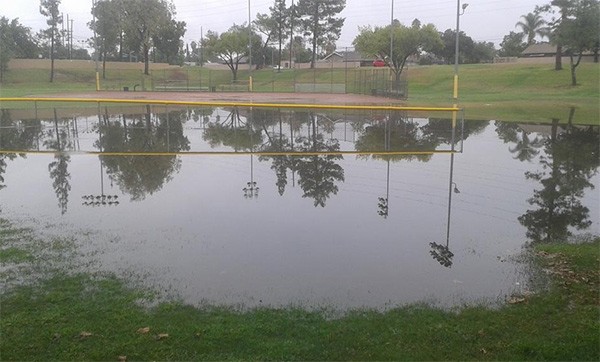"""<div class=""""meta image-caption""""><div class=""""origin-logo origin-image kabc""""><span>KABC</span></div><span class=""""caption-text"""">ABC7 viewer Dave Sparks shared this photo of a flooded baseball field at Don Lorenzi Park in Riverside on Tuesday, Sept. 15, 2015. (Dave Sparks/ Twitter)</span></div>"""