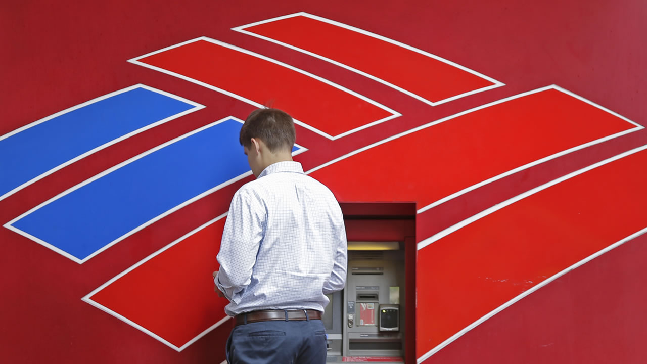 A customer uses a Bank of America ATM near the company's headquarters in Charlotte, N.C., Tuesday, July 7, 2015.