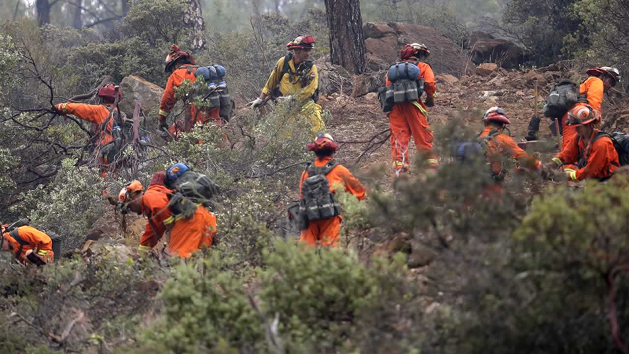 "<div class=""meta image-caption""><div class=""origin-logo origin-image none""><span>none</span></div><span class=""caption-text"">Firefighters work on a ridge line as they clear brush Monday, Sept. 14, 2015, near Middletown, Calif. (AP Photo/Elaine Thompson)</span></div>"