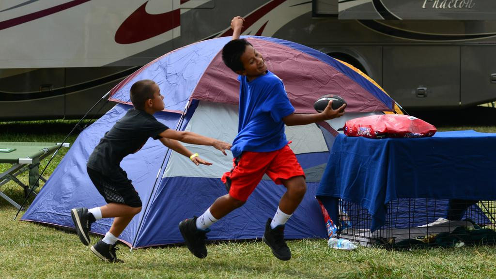 "<div class=""meta image-caption""><div class=""origin-logo origin-image none""><span>none</span></div><span class=""caption-text"">Children play near evacuee tents set up at the Napa County Fairgrounds in Calistoga, Calif. on Tuesday, September 15, 2015. (KGO-TV)</span></div>"