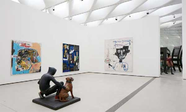 "<div class=""meta image-caption""><div class=""origin-logo origin-image none""><span>none</span></div><span class=""caption-text"">The installation of works by Jean-Michel Basquiat, John Ahearn and Robert Therrien in The Broad's third-floor galleries. (Photo by Bruce Damonte courtesy of The Broad and Diller Scofidio + Renfro)</span></div>"