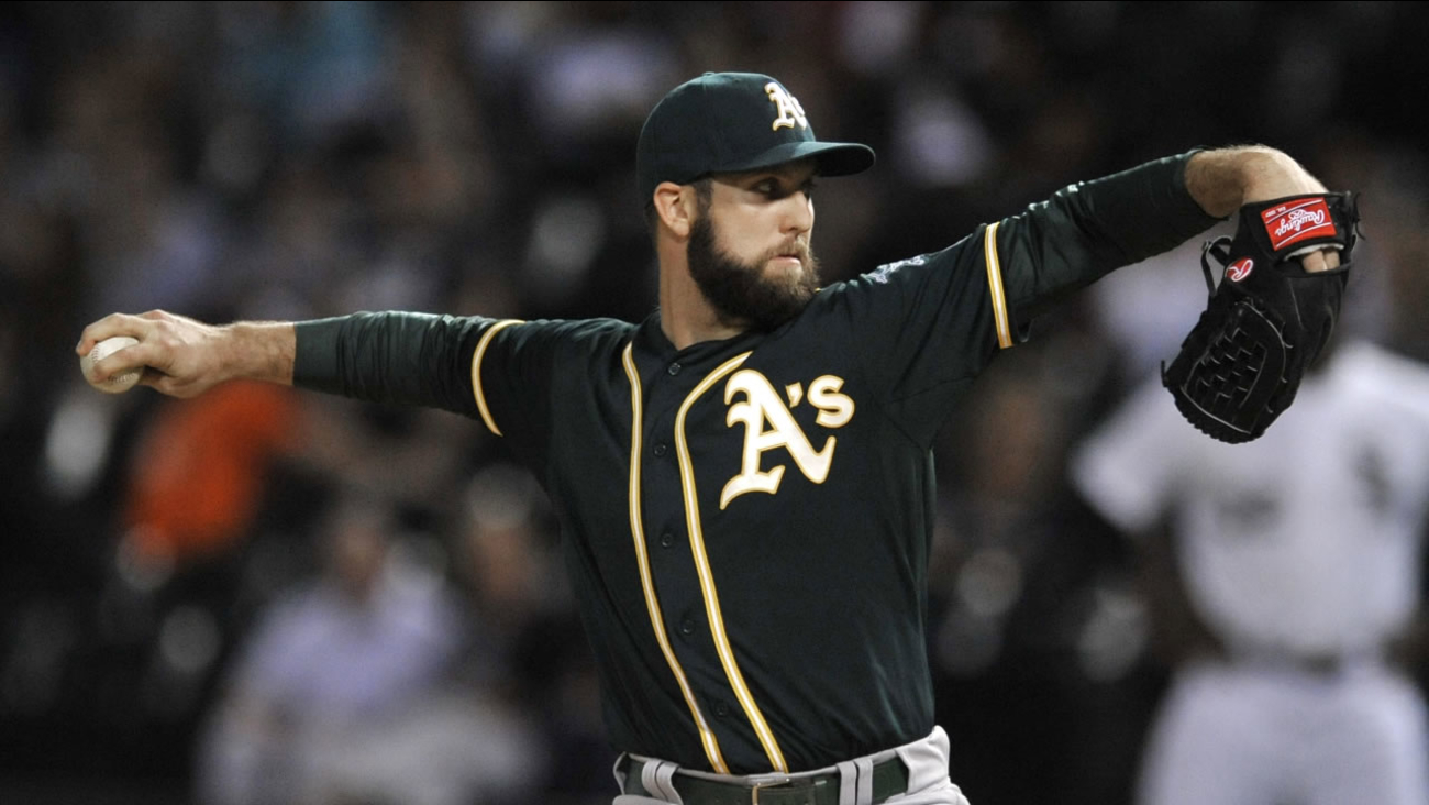 Oakland Athletics starter Cody Martin winds up during the first inning of a baseball game against the Chicago White Sox on Wednesday, Sept. 16, 2015, in Chicago.