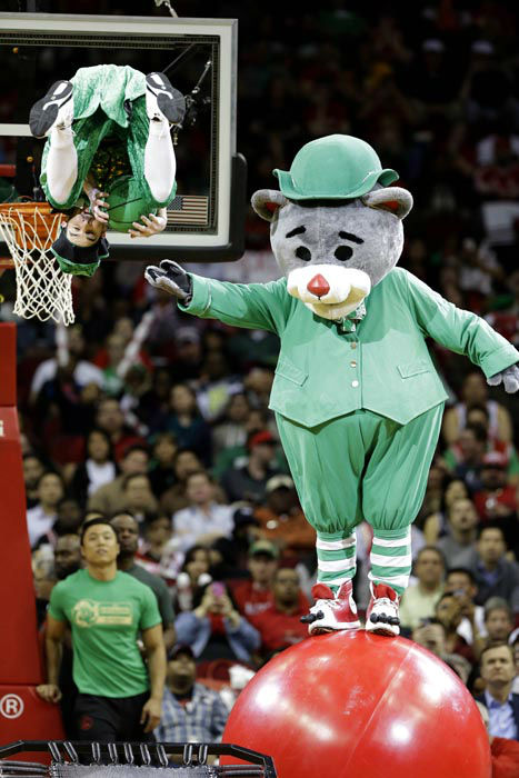 "<div class=""meta image-caption""><div class=""origin-logo origin-image none""><span>none</span></div><span class=""caption-text"">Wearing green for St. Patrick's day, Houston Rockets mascot Clutch balances on a ball as a leprechaun flips to the basket. (AP Photo/ Pat Sullivan)</span></div>"