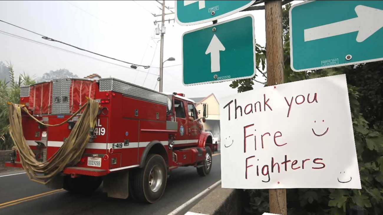 "Firefighters pass a ""Thank you"" sign in Angels Camp, Calif., on their way for another day of battling the Butte Fire, Sunday, Sept. 13, 2015."