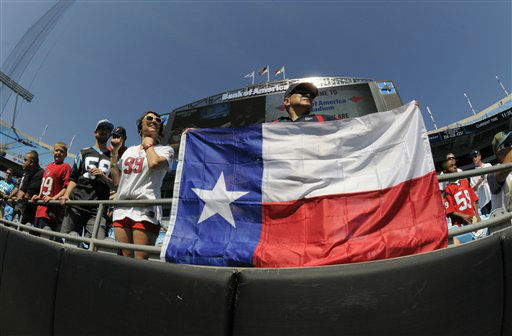 "<div class=""meta image-caption""><div class=""origin-logo origin-image none""><span>none</span></div><span class=""caption-text"">Houston Texans fans watch their team warm up against the Carolina Panthers before an NFL football game in Charlotte, N.C., Sunday, Sept. 20, 2015. (AP Photo/ Mike McCarn)</span></div>"