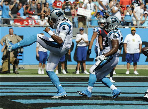 "<div class=""meta image-caption""><div class=""origin-logo origin-image none""><span>none</span></div><span class=""caption-text"">Carolina Panthers' Cam Newton (1) celebrates his touchdown run against the Houston Texans (AP Photo/ Mike McCarn)</span></div>"