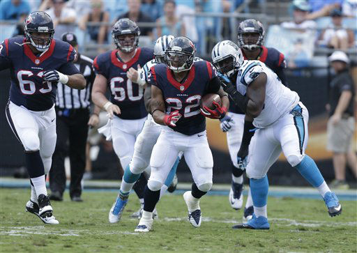 "<div class=""meta image-caption""><div class=""origin-logo origin-image none""><span>none</span></div><span class=""caption-text"">Houston Texans' Chris Polk (22) runs against the Carolina Panthers (AP Photo/ Bob Leverone)</span></div>"