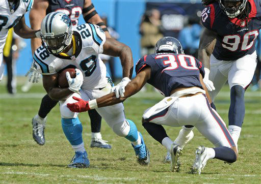 "<div class=""meta image-caption""><div class=""origin-logo origin-image none""><span>none</span></div><span class=""caption-text"">Carolina Panthers' Jonathan Stewart (28) runs past Houston Texans' Kevin Johnson (30) during the second half (AP Photo/ Mike McCarn)</span></div>"