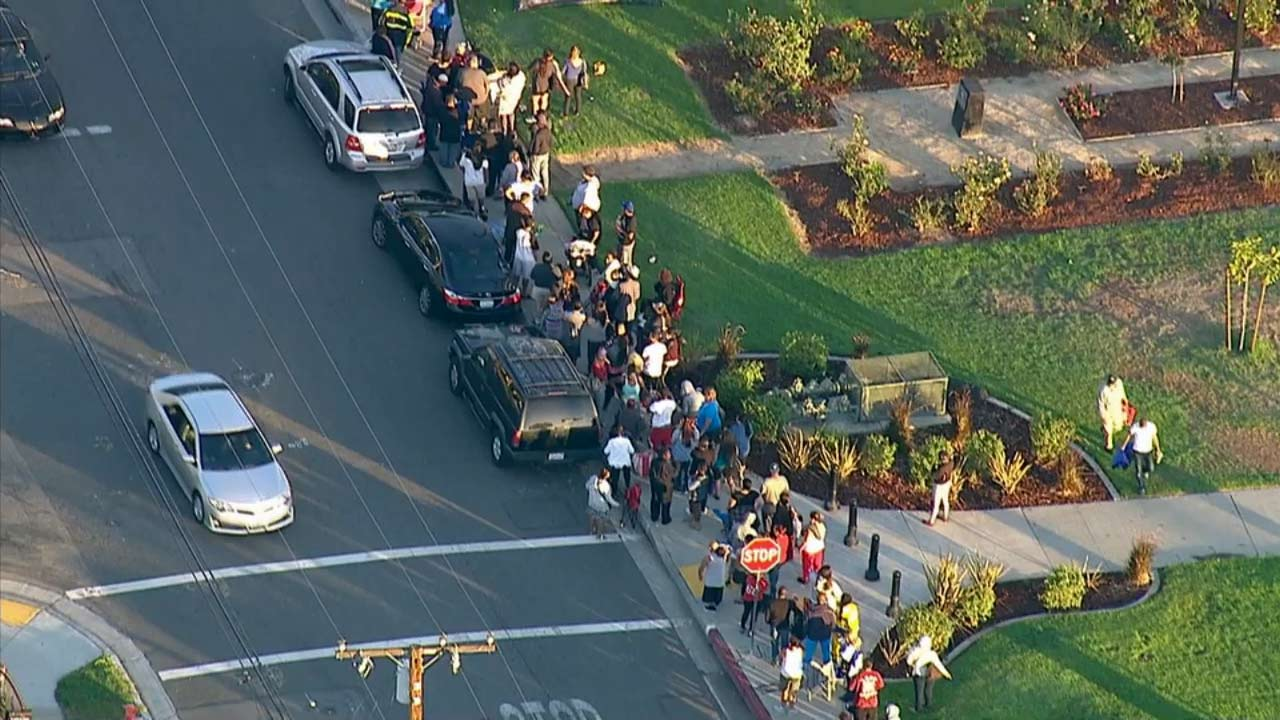 Hundreds of people stood in line as the Norwalk Housing Authority began to hand out housing vouchers to low-income families Monday, Sept. 21, 2015.