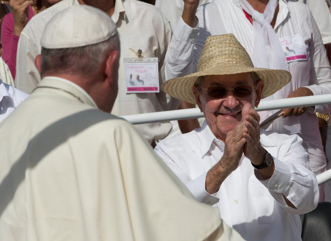 "<div class=""meta image-caption""><div class=""origin-logo origin-image none""><span>none</span></div><span class=""caption-text"">Cuba's President Raul Castro applauds as Pope Francis arrives at the Plaza of the Revolution to celebrate a Mass, in Holguin, Cuba, Monday, Sept. 21, 2015. (AP Photo/Alessandra Tarantino)</span></div>"
