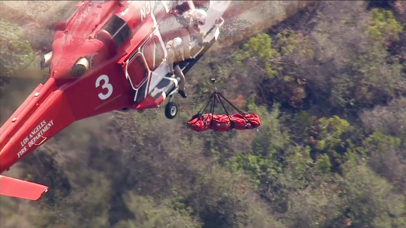 An injured hiker had to be airlifted to safety by Los Angeles County fire crews in the Pacific Palisades on Monday, Sept. 21, 2015.
