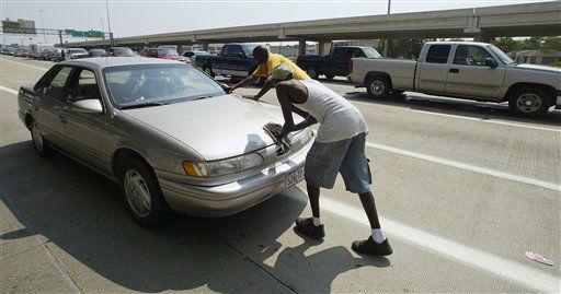 "<div class=""meta image-caption""><div class=""origin-logo origin-image none""><span>none</span></div><span class=""caption-text"">Evacuees push their car along Interstate-45 after it broke down in Houston on Thursday, Sept. 22, 2005. (AP Photo/Rick Bowmer) (AP Photo/ RICK BOWMER)</span></div>"