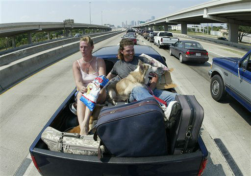 """<div class=""""meta image-caption""""><div class=""""origin-logo origin-image none""""><span>none</span></div><span class=""""caption-text"""">Cherlyn, left, and Lane McWhorter of Baycliff, TX ride in the back of a pickup truck with their animals in Houston, Thursday, Sept. 22, 2005. (AP Photo/Rick Bowmer) (AP Photo/ RICK BOWMER)</span></div>"""