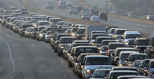 """<div class=""""meta image-caption""""><div class=""""origin-logo origin-image none""""><span>none</span></div><span class=""""caption-text"""">Cars are bumper to bumper on Interstate 45 near downtown Houston on Thursday, Sept. 22, 2005.  (AP Photo/Rick Bowmer) (AP Photo/ RICK BOWMER)</span></div>"""