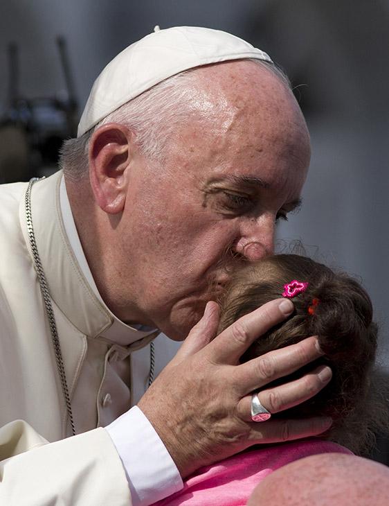 "<div class=""meta image-caption""><div class=""origin-logo origin-image ap""><span>AP</span></div><span class=""caption-text"">Pope Francis kisses a child as he arrives at the Metropolitan Cathedral to celebrate Mass in Santiago de Cuba, Cuba, Tuesday, Sept. 22, 2015. (AP Photo/Eduardo Verdugo)</span></div>"
