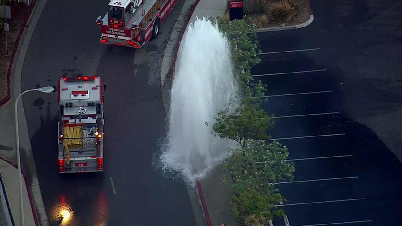 A hit-and-run driver sheared a fire hydrant near Olive View Drive and Bledsoe Street in Sylmar on Monday, Sept. 21, 2015.
