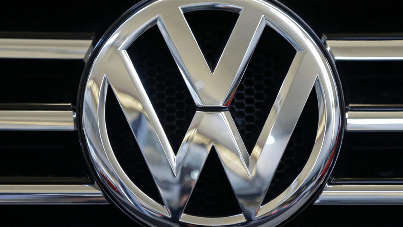 In this photo taken Feb. 14, 2013, a Volkswagen logo is seen on the grill of a Volkswagen on display in Pittsburgh.