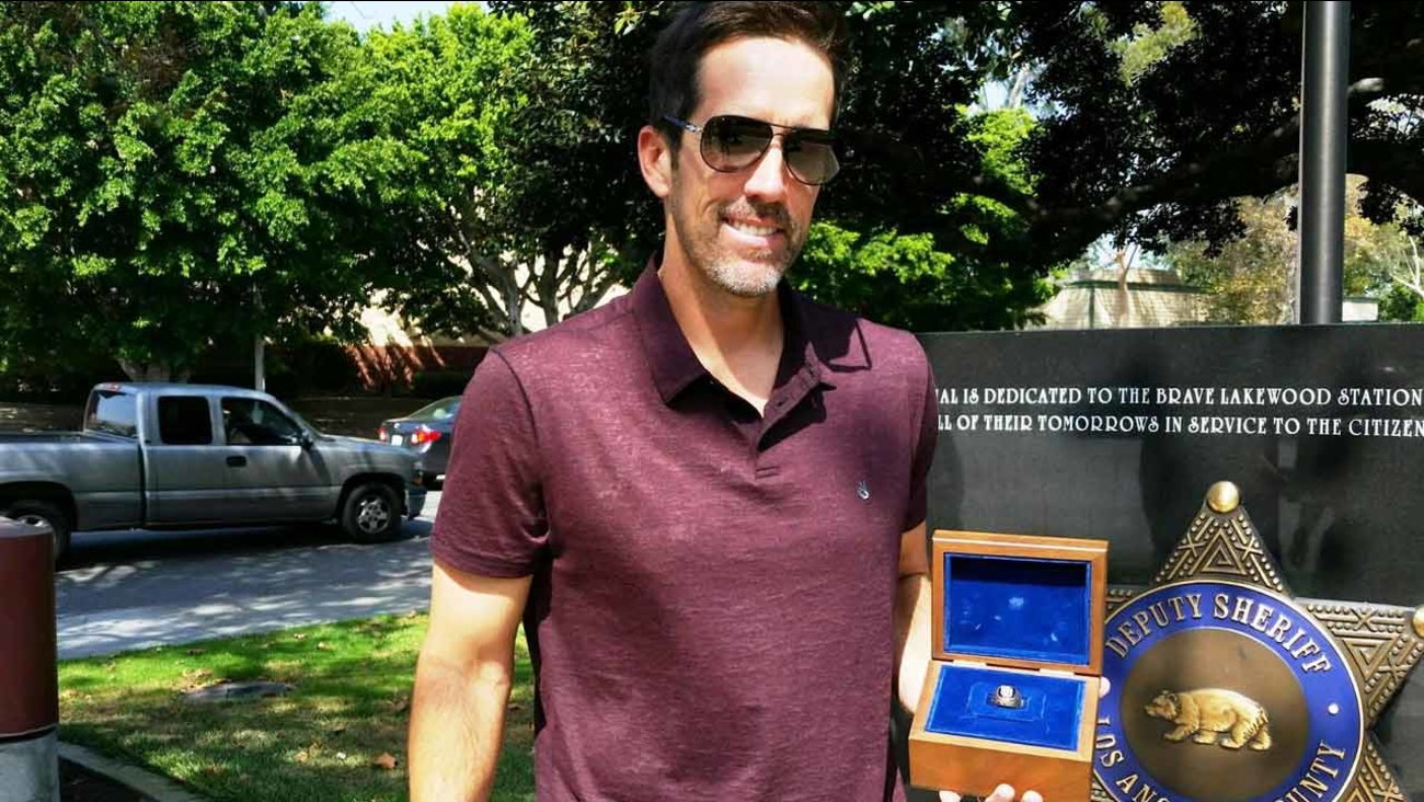 Former MLB player Christopher Gomez gets his championship ring returned after an unknown Good Samaritan dropped it off at the Lakewood sheriff's station Sunday, Sept. 20, 2015.