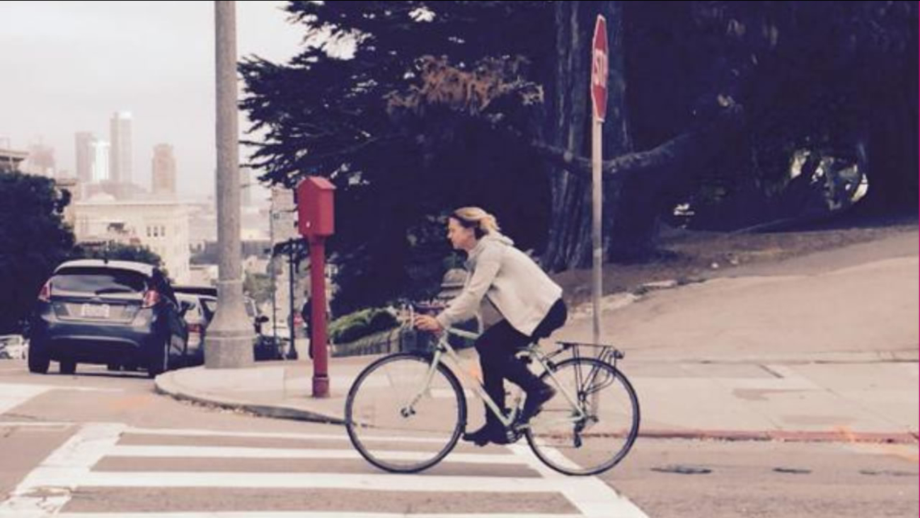 A cyclist rides throught San Francisco city streets Sept. 22, 2015 City lawmakers could pass an ordinace to de-prioritize ticketing cyclists who fail to stop at stop signs.